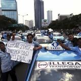 Uber, Grab bị siết ở Indonesia