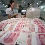 Đầu tư của Trung Quốc ra nước ngoài giảm gần một nửa
