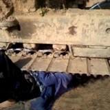 Phản đối thi công, một phụ nữ bị máy xúc chèn qua người