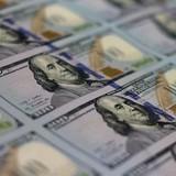 Đồng USD quay đầu giảm vì chỉ báo kinh tế yếu kém