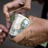 HSBC: Cuối năm 2015, tiền đồng có thể giảm giá thêm 2%
