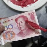 PBoC tăng giá nhân dân tệ mạnh nhất nửa tháng