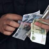 Két tiền của Trung Quốc giảm nhẹ