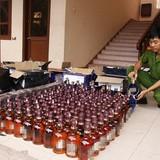 Vận chuyển 364 chai rượu lậu trên Quốc lộ 1