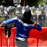 [Ảnh] Đụng độ giữa cảnh sát và người biểu tình tại Venezuela