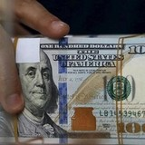 Đồng USD đứng im khi kế hoạch giảm thuế ở Mỹ chưa rõ ràng
