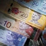 Tiền tệ các nước mới nổi lại lao dốc vì kinh tế Mỹ và Trung Quốc