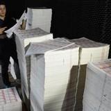 Triệt phá đường dây in tiền giả cực lớn ở Trung Quốc