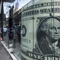 Tín hiệu tăng lãi suất của Fed không cứu được phiên USD giảm giá