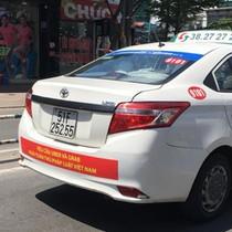 TP.HCM yêu cầu chấm dứt dán băng rôn phản đối Grab, Uber