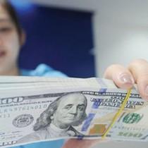 Đồng USD mất giá mạnh sau khi Fed nâng lãi suất