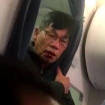 Cảnh David Dao tranh cãi trước khi bị kéo lê khỏi máy bay
