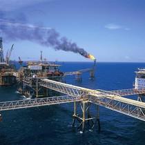 Giảm khai thác dầu, xuất khẩu điện thoại làm chậm tăng trưởng