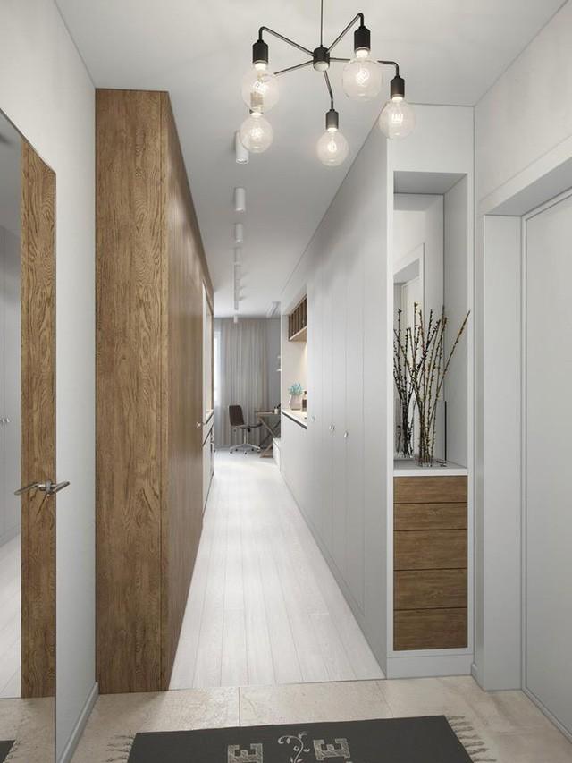 Toàn bộ lối vào nhà là được tận dụng bố trí tủ cao sát trần giúp chủ nhà có thật nhiều không gian trữ đồ.