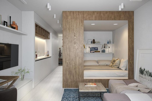 Không gian nghỉ ngơi vô cùng thoáng đẹp được đặt lên cao so với sàn nhà. Bên trong chiếc giường hộp đặc biệt này còn được trang trí bắt mắt bằng những kệ nhỏ đặt sole.