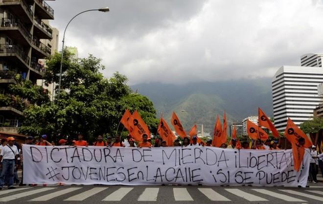 Cuộc biểu tình ở Caracas ngày 26/10 - Ảnh: Reuters.