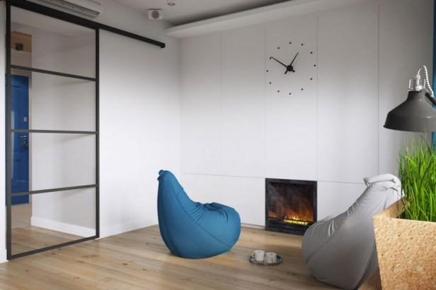 Một bên phòng được bố trí lò sưởi cùng 2 chiếc ghế lười. Một góc nghỉ ngơi ấm áp cho những ngày đông lạnh giá.