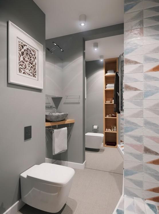 Sâu bên trong là khu vực nhà tắm với những thiết bị nội thất sang trọng. Để mở rộng chiều sâu cho khu vực này chủ nhà không quên treo một tấm gương lớn.