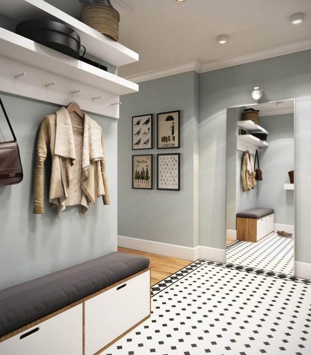 Một chiếc gương lớn giúp nhân đôi diện tích và tạo chiều sâu cho góc nhỏ vào nhà. Nơi đây cũng là góc sửa sang lại trang phục mỗi khi chủ nhà cần ra ngoài.