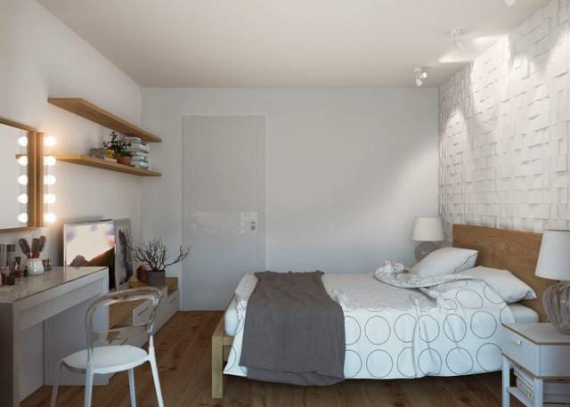 Phòng ngủ được bài trí đơn giản mà đẹp mắt với bức tường gạch thô sơn trắng đầu giường và hệ thống đền trần lạ mắt.