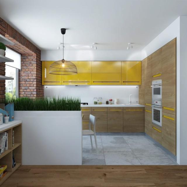 Nối liền phòng khách là bếp ăn nhỏ. Góc nhỏ này được thiết kế nổi bật với tủ bếp màu vàng chanh trên nền bức tường trắng.