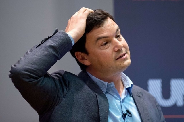 French economist Thomas Piketty speaks to students and guests during a presentation at Kings College, central London, on April 30, 2014. Piketty said that he hoped to create a