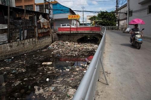 Kinh hoàng bãi chứa rác thải điện tử lớn nhất thế giới ở Trung Quốc - ảnh 3