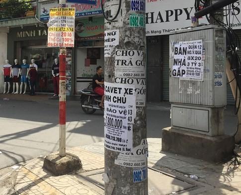 Rác quảng cáo đủ loại 'tra tấn' người dân Sài Gòn - ảnh 2