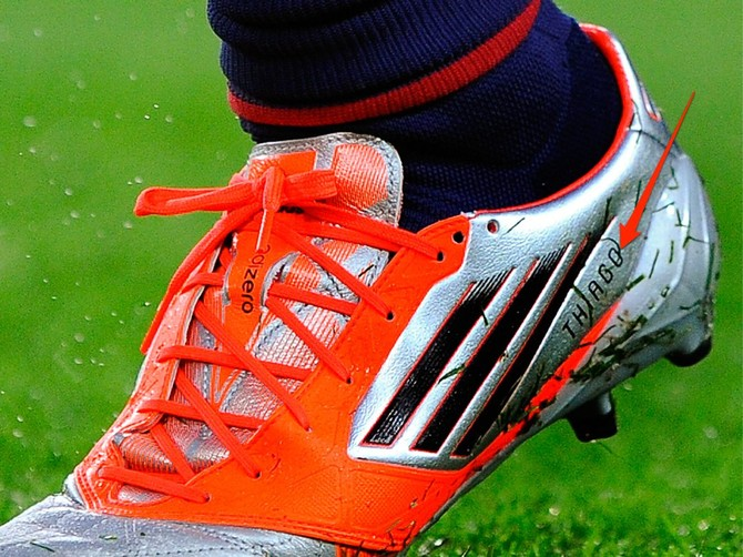 Messi has his name on his boots.