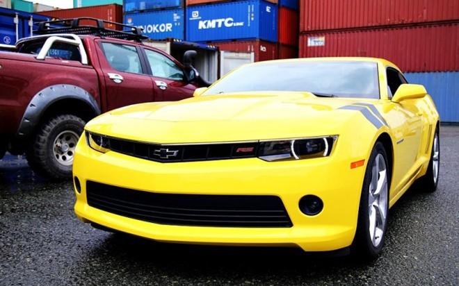 Chevrolet Camaro RS 2014 trang bị động cơ V6 dung tích 3.6 lít. Khối động cơ này cho công suất cực đại 323 mã lực và mô-men xoắn cực đại 278 Nm. Xe có khả năng tăng tốc từ 0-100 km/h chỉ trong vòng 5,8 giây. Ảnh: otosaigon.com.