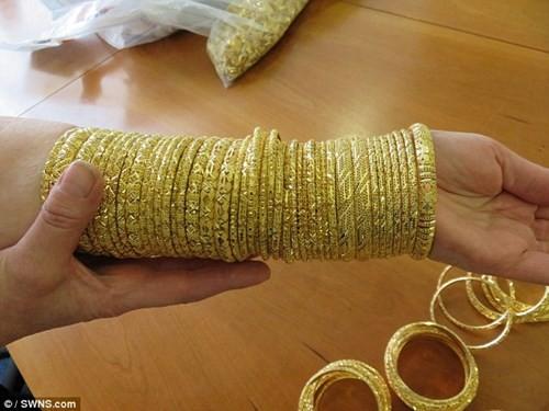 Đấu giá 150 kg vàng buôn lậu được định giá 82,5 tỉ đồng - ảnh 7