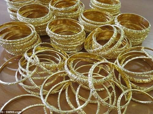 Đấu giá 150 kg vàng buôn lậu được định giá 82,5 tỉ đồng - ảnh 6