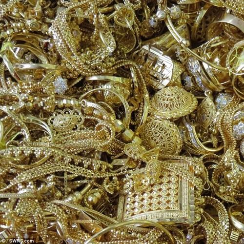 Đấu giá 150 kg vàng buôn lậu được định giá 82,5 tỉ đồng - ảnh 1