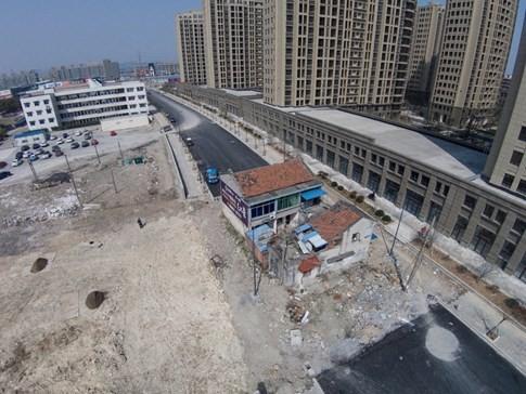 [ẢNH] Những căn nhà 'lì lợm' không chịu giải tỏa ở Trung Quốc - ảnh 6