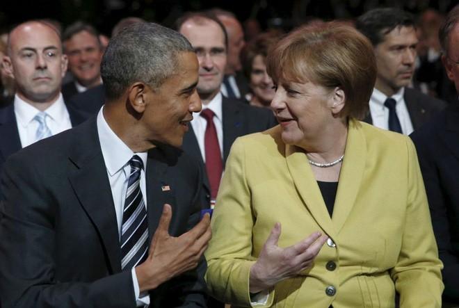 Ông Obama và bà Merkel dự lễ khai mạc triển lãm công nghiệp Hannover Messe ở Hannover, Đức, ngày 24/4/2016 - Ảnh: Reuters.