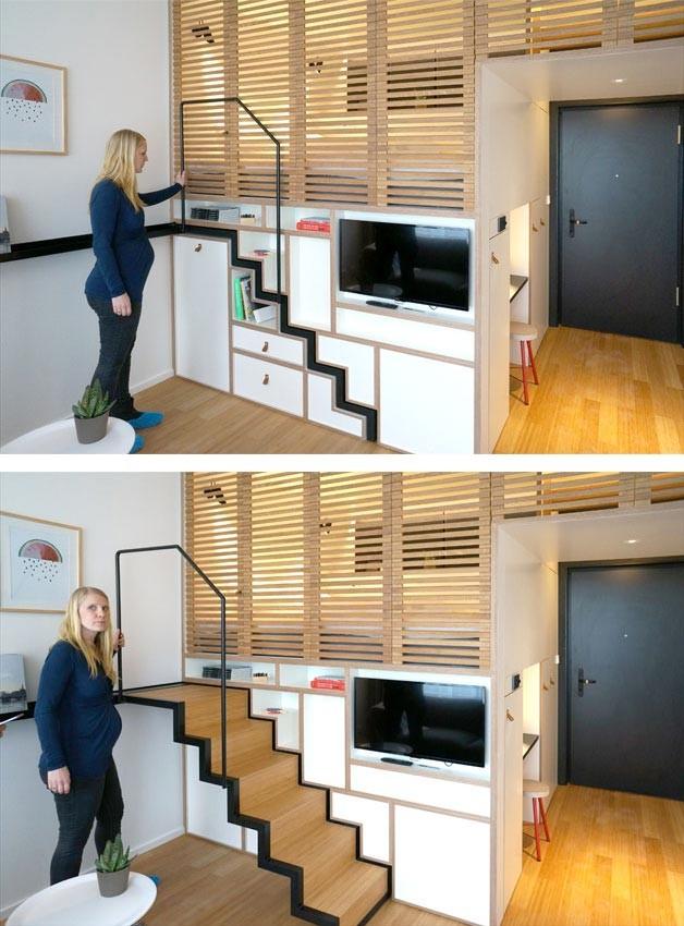 Chiếc cầu thang dẫn lên gác xép có thể dễ dàng thu gọn lại khi không cần thiết, giúp ngôi nhà vô cùng gọn gàng sáng sủa.