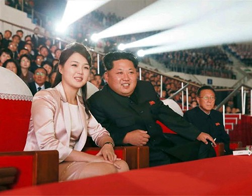 Kim Jong-un and his wife Ri Sol-ju watch a joint performance by the State Merited Chorus and the Moranbong Band to mark the 70th anniversary of the founding of the Workers Party of Korea