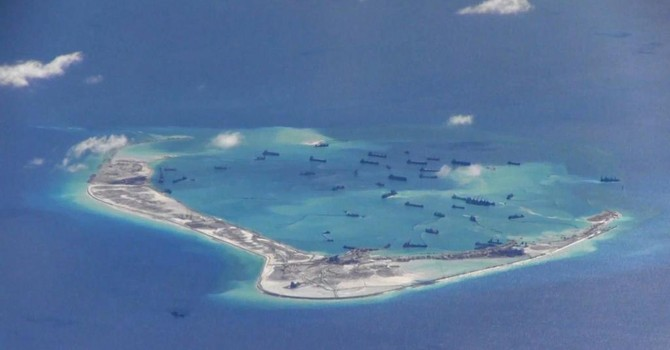 Bị tố cáo, Trung Quốc tuyên bố sắp dừng bồi đắp bãi ngầm ở Biển Đông