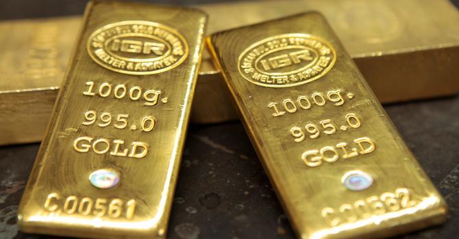 Giá vàng chạm đáy 1 tuần sau số liệu kinh tế Mỹ khởi sắc