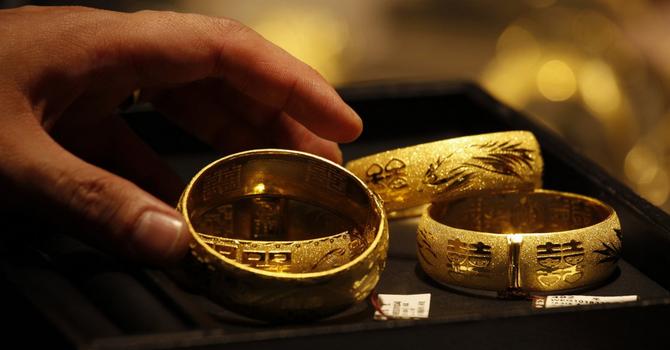 Giá vàng tăng bất chấp sức ép từ đồng USD