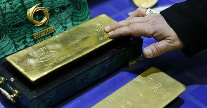 Giá vàng leo dốc ngược hướng giá USD