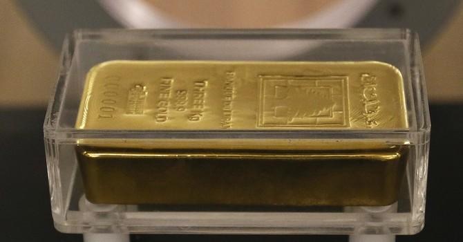 """Giá vàng """"kẹt"""" trong quãng 1.060 - 1.080 USD/oz"""