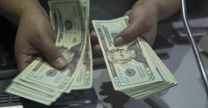 Đồng USD lập đáy 5 tuần so với yen vì ông Trump gây thất vọng