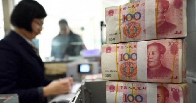 Trung Quốc giảm giá 0,12% nhân dân tệ