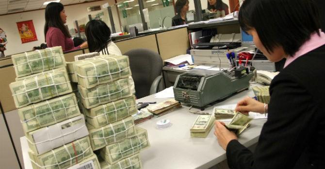 Tham gia TPP, Việt Nam có thể gặp khó nếu muốn điều chỉnh tỷ giá mạnh