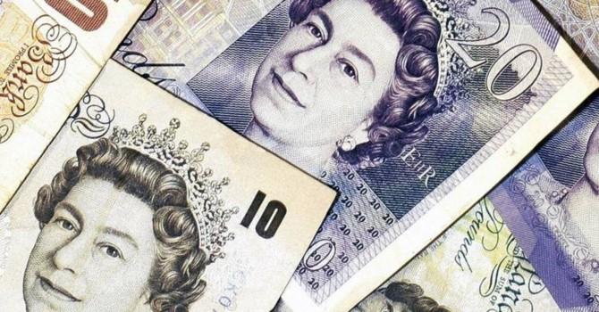 Đồng USD tăng nhanh, Bảng Anh lao dốc trong phiên giao dịch 13/6