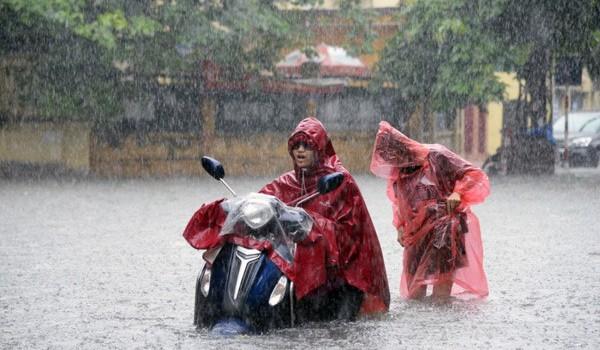 Mưa lớn trên cả nước do áp thấp nhiệt đới, nhiệt độ Bắc Bộ giảm 3 độ C