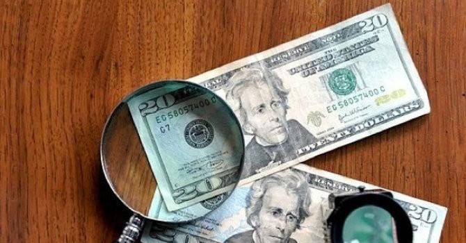 Tài chính 24h: Xuất hiện đồng đô la Mỹ giả có chữ Trung Quốc