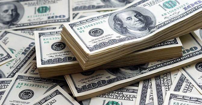Đồng USD rời đỉnh 1 tháng