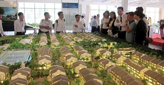 Căn hộ Hà Nội, TP.HCM: Thanh khoản tụt thấp, giá bán giảm